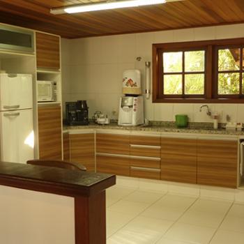 Qual o melhor revestimento para casa de madeira maciça pré-fabricada