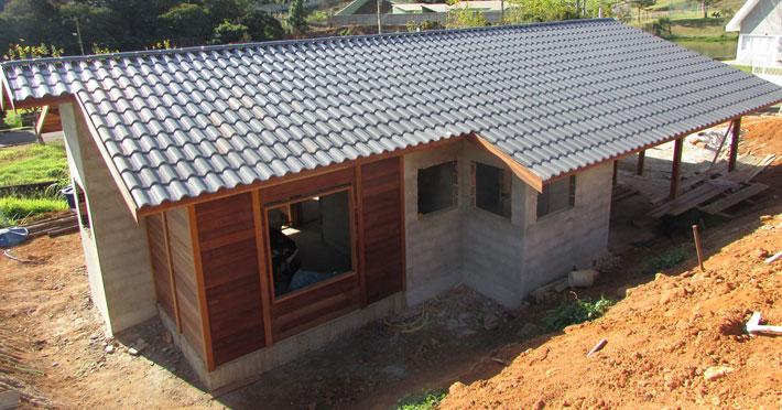 casa de madeira em extrema mg