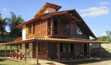 Casas pré-fabricadas de madeira maciça vantagens e desvantagens